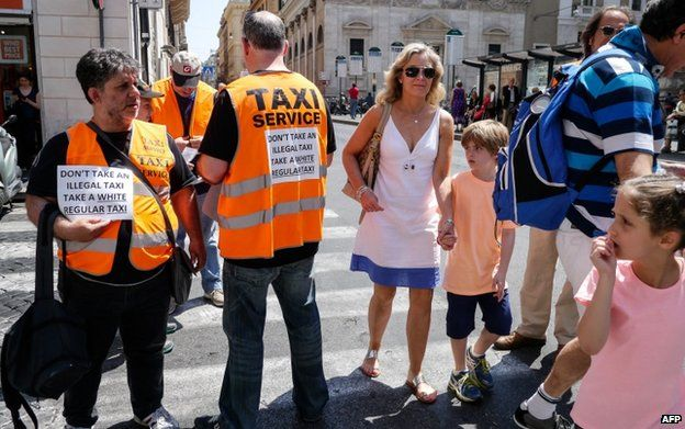 Rome taxis drivers distribute leaflets during strike