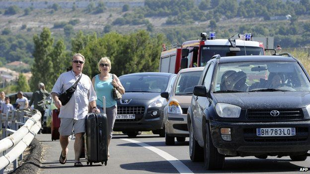 Passengers in Marignane near Marseille walk to the airport