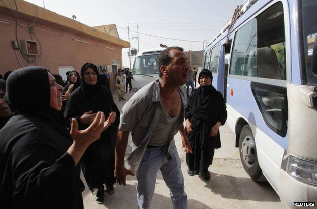 Mourners in Najaf, southern Iraq, 12 June