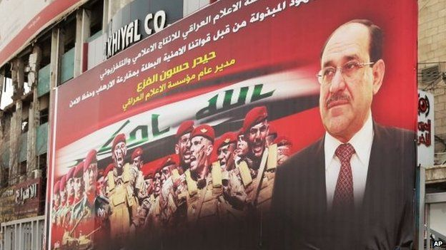 An anti-terrorism banner with a photo of Iraqi Prime Minister Nouri Maliki, in Baghdad, Iraq (18 March 2014)