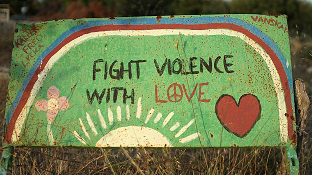 Sign with words 'Fight violence with love'