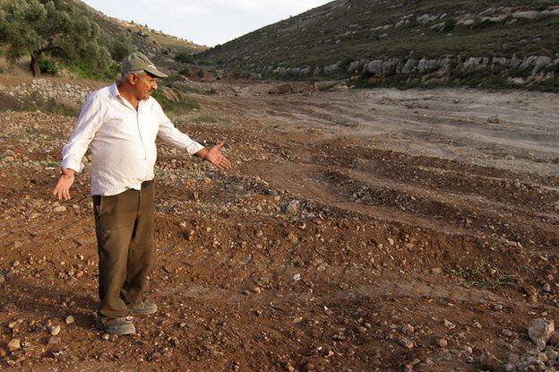 Daher Nassar standing where the orchard used to be