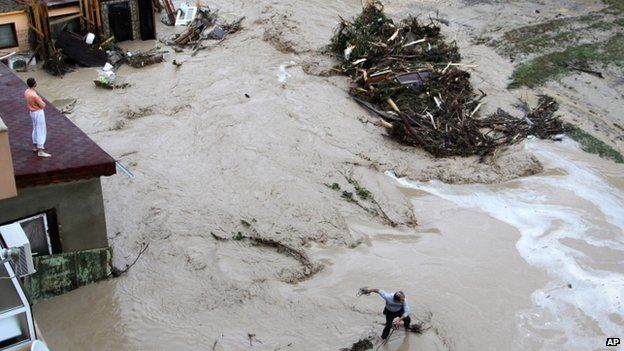 People try to protect themselves from floodwater in the Black sea town of Varna