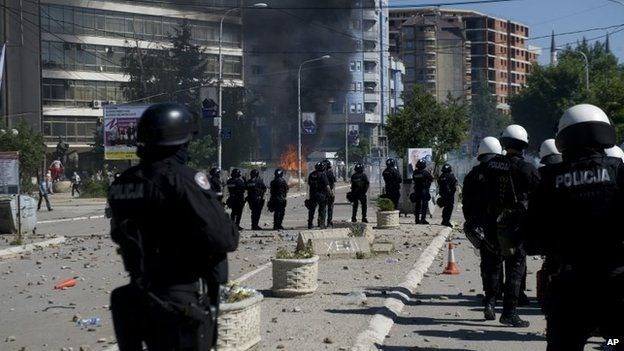 Kosovo police in riot gear deploy to disperse a crowd of hundreds of stone-throwing protestors who demanded removal of a blockade of flower pots on a bridge linking ethnic Albanians and Serbs in the ethnically divided town of Mitrovica on 22 June 2014