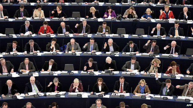 Members of the European Parliament take part in a vote during a plenary session at the European Parliament in Strasbourg (12 March 2014)