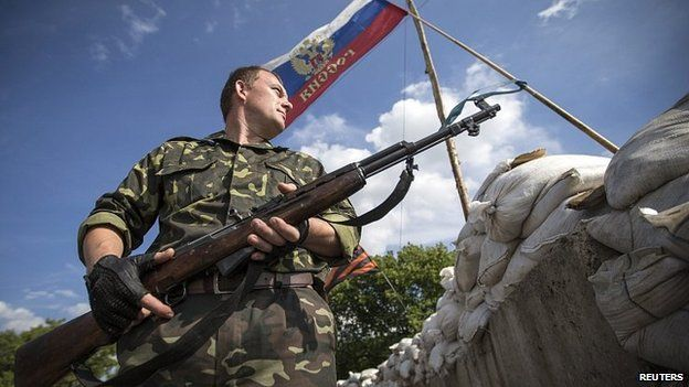 Pro-Russian separatist at checkpoint outside town of Lysychansk in Luhansk region of eastern Ukraine. 24 June 2014