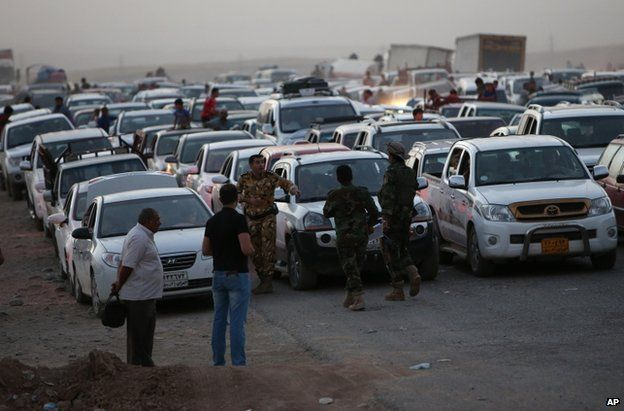 Fleeing Iraqis near the Kurdish city of Irbil, 25 June