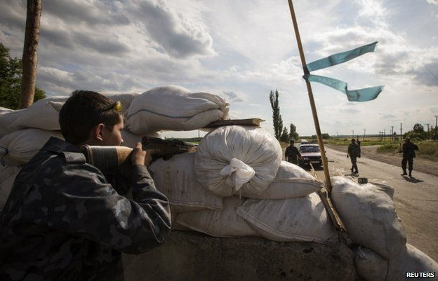 Pro-Russian separatists at a checkpoint in Luhansk region (24 June)