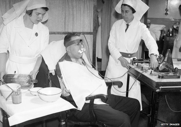 7th July 1936 - a hay fever patient undergoes electrical treatment