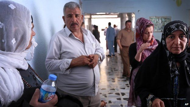 Relatives of Kurdish peshmerga fighters, wounded in fighting with Isis militants, visit a hospital in Irbil, a city in the Kurdish controlled north 350km north of Baghdad