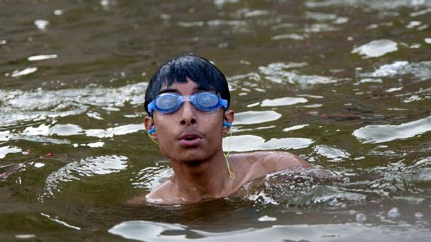 Boy wearing goggles in the Ganges