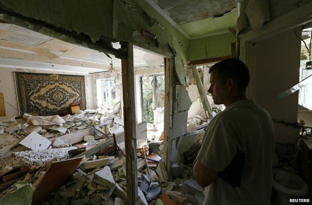 A resident stands inside a flat destroyed by shelling in Kramatorsk, 1 July