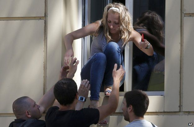 People are evacuated to safety from a hospital in Donetsk city during fighting, 1 July