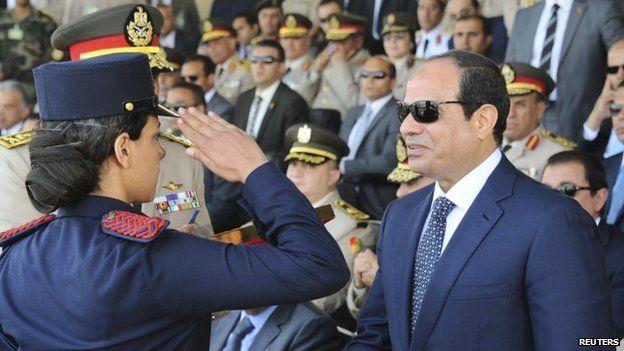 Egypt President Abdul Fattah al-Sisi (R) at a military graduation ceremony in Cairo on 24 June