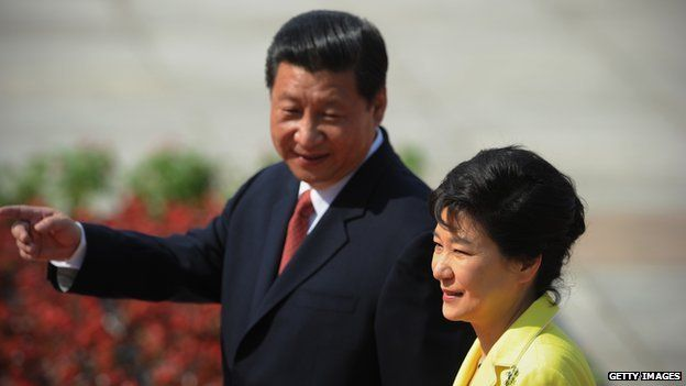 South Korean President Park Geun-Hye and Chinese President Xi Jinping inspect Chinese honour guards during a welcoming ceremony outside the Great Hall of the People on 27 June, 2013 in Beijing, China