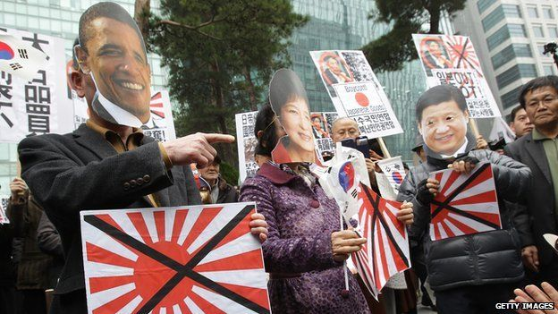 South Korean conservative protesters wear masks of US President Barack Obama, South Korean President Park Geun-hye and Chinese President Xi Jinping in front of Japanese embassy on 1 March, 2014 in Seoul, South Korea
