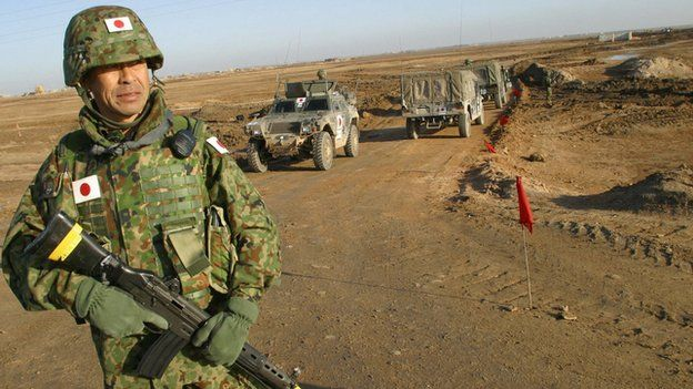 A Japanese soldier stands on guard during a visit by Japanese Self-Defence Force Commander Lt-Col Masahisa Sato to the area where a Japanese military base for troops in Iraq will be established in al-Muthanna province on 28 January 2004