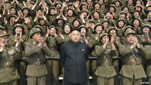 North Korean leader Kim Jong Un receives applause as he guides the multiple-rocket launching drill of women's sub-units under KPA Unit 851, in this undated photo released by North Korea's Korean Central News Agency on 24 April, 2014