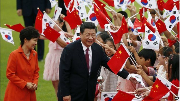 Chinese President Xi Jinping, right, and his South Korean counterpart Park Geun-hye, left, greet children during a welcome ceremony at the Presidential Blue House in Seoul, South Korea, on 3 July 2014.