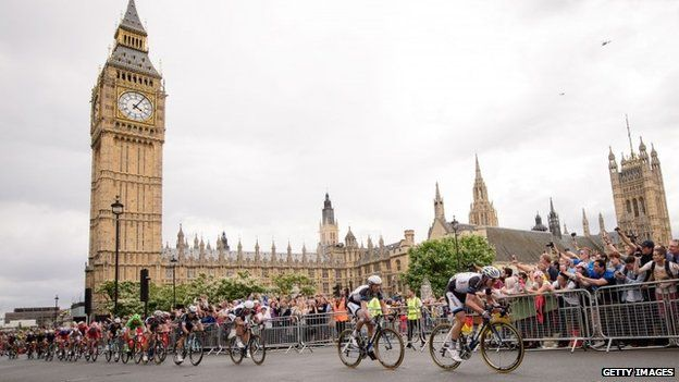 Riders pass the Houses of Parliament