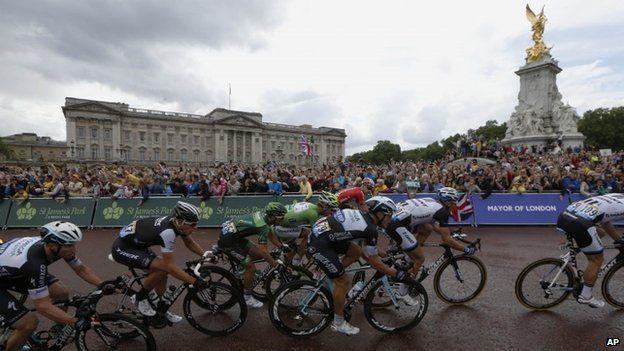 Riders pass Buckingham Palace