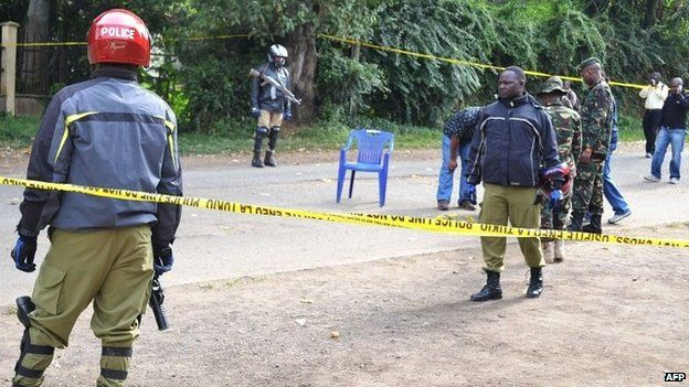 Police cordon off the site of a bomb attack on July 8, 2014 in Arusha, nothern Tanzania, that injured eight people late the night before.