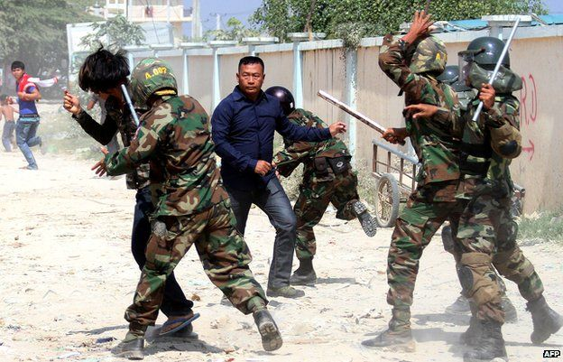 Cambodian soldiers clash with protesters during a garment workers' protest to demand higher wages in front of a factory in Phnom Penh on 2 January 2014.