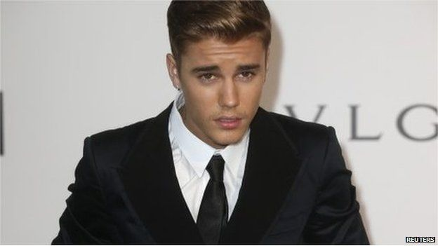 """Canadian pop singer Justin Bieber arrives for amfAR""""s Cinema Against AIDS 2014 event in Antibes during the 67th Cannes Film Festival 22 May 2014"""