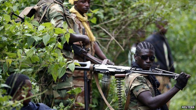 A Seleka fighter holds his machine gun near the town of Kuango, close to the border with Democratic Republic of Congo - 9 June 2014