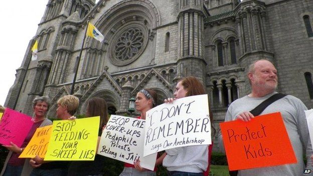 Protesters against clerical child abuse gather outside the Cathedral Basilica in St. Louis in June 2014