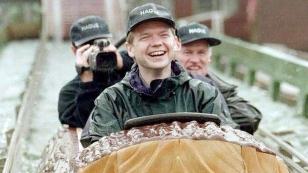 William Hague on a water slide