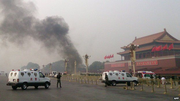 This file photo taken on 28 October, 2013 shows police cars blocking off the roads leading into Tiananmen Square after a vehicle loaded with petrol crashed in front of Tiananmen Gate in Beijing