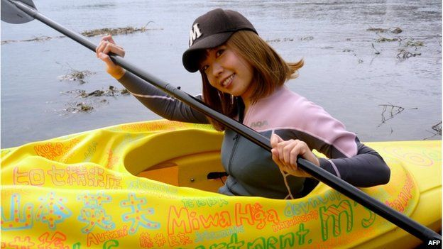 This handout picture taken by Rokudenashiko and Marie Akatani on 19 October 2013 shows artist Megumi Igarashi paddling a kayak designed to be the shape of her own vagina in Tokyo.