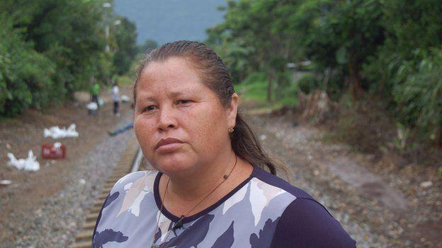 Norma Romero stands on the railway tracks in June 2014
