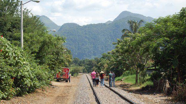 Las Patronas walk along the railway track in June 2014