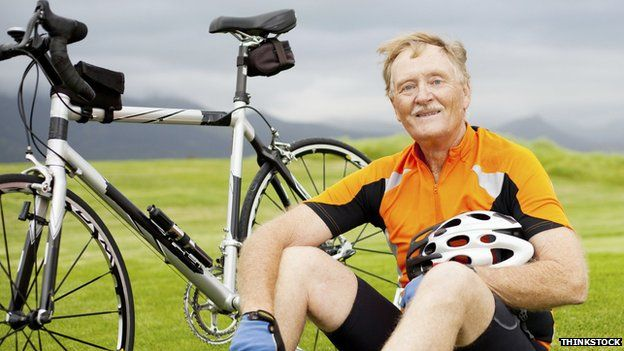 Elderly man and bike