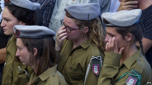 Israeli soldiers attend the funeral of their comrade Staff Sgt Amit Yeori, 20, in Jerusalem, 27 July 2014