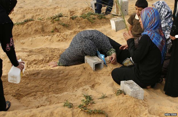 A Palestinian mother mourns her son in Beit Lahiya, northern Gaza, 28 July