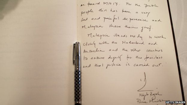 A close-up of the message written by Malaysian PM Najib Razak in the book of condolence for the victims of Malaysia Airlines flight MH17 on 31 July 2014 in The Hague, Netherlands.