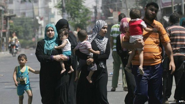 """Palestinians leave their neighbourhood to head to a safer location as Israel""""s army continued to shell the area of Rafah"""