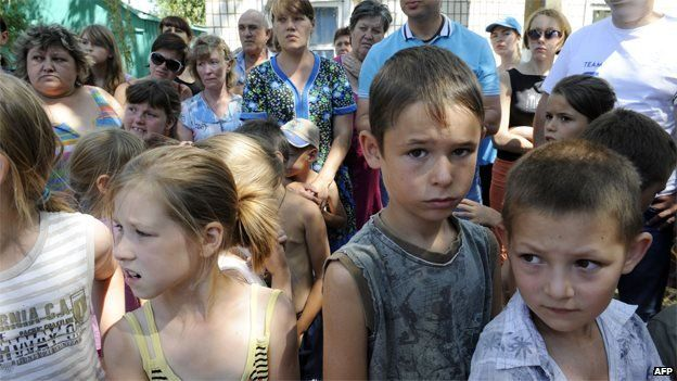 Women and children shelter near Mariupol, in the government-controlled south of Donetsk region