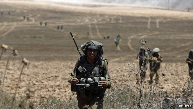 Israeli troops from the Givati brigade return from Gaza