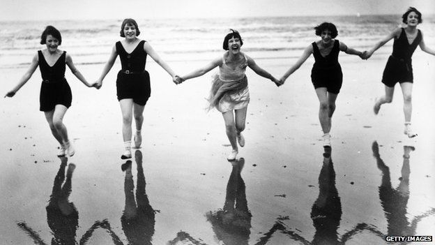 Members of the Brighton Swimming Club take advantage of an early summer to visit the beach