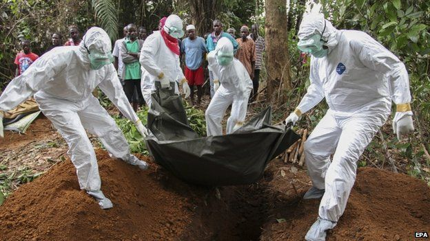 Liberian nurses carry the body of an Ebola victim on the way to bury them in the Banjor Community on the outskirts of Monrovia, Liberia, on 6 August 2014.