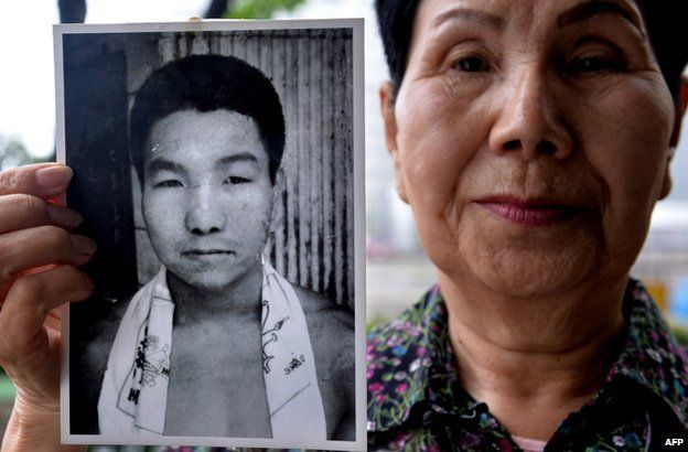 Hideko Hakamada holds a photograph of her brother Iwao as a young man