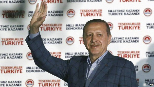 Turkish Prime Minister Recep Tayyip Erdogan acknowledges supporters after his presidential election victory, in Ankara