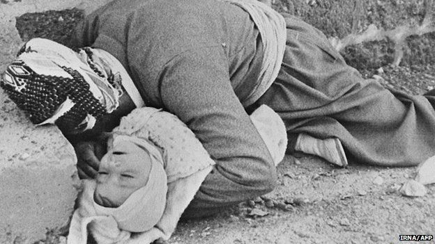 Kurd father holding his baby after Iraqi chemical attack on the city of Halabja, northeastern Iraq