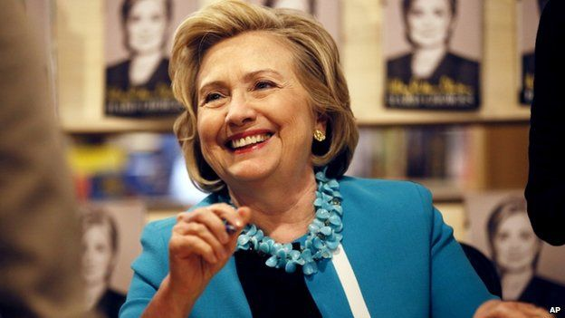 """Hillary Rodham Clinton signs copies of her new book """"Hard Choices"""" at the Common Good Books store on 20 July 2014 in St Paul, Minnesota"""