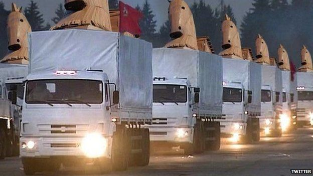 Photoshopped picture of trucks with horse heads on top