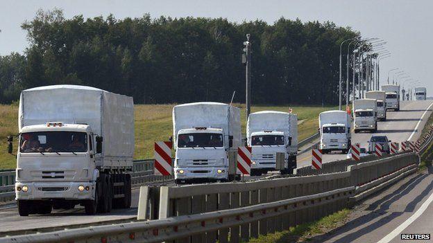 Convoy of white trucks